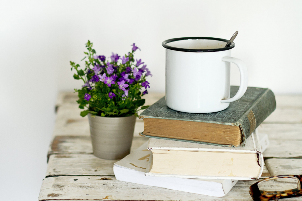 Encouraging Books For Christian Mothers - Stock Photo flower, stack of books, coffee