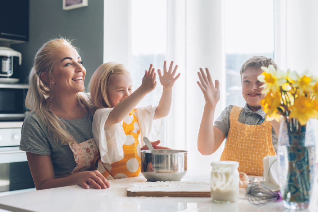 Homeschooling Mom baking with her son and daughter
