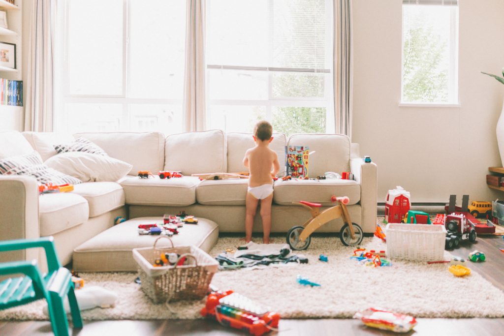 Messy House with a little boy in his diaper