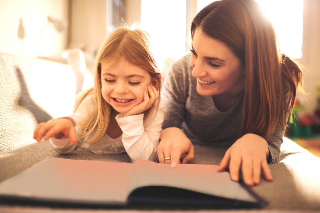 Mom and Young Girl Reading A Book Together