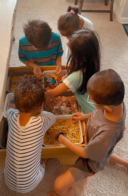 Young Children Playing with a Sensory Table