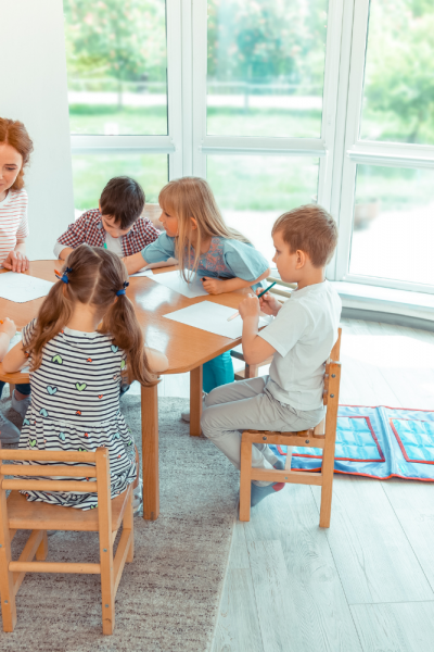 Mom and Children Around A Table